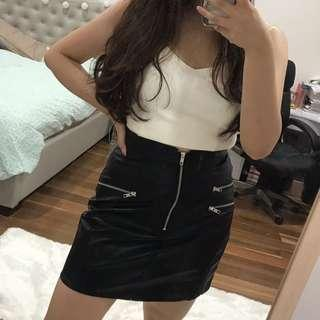 Tight leather skirt, zips detailing