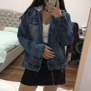 Denim jacket with grey hood