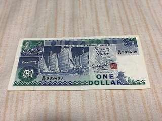 1987 Singapore $1 Ship with Almost Solid 999499