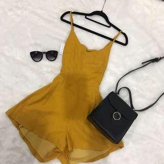Summer yellow playsuit with bow tie detailing at the back
