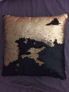 black and gold sequin cushion