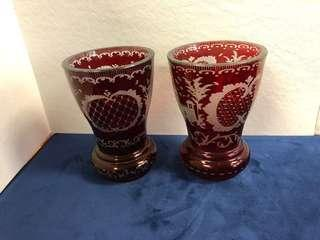 Two ruby red bohemian crystal cut vase