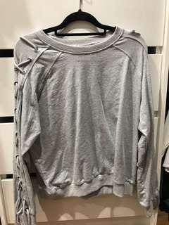 Grey sweatshirt jumper with Criss cross arm detailing