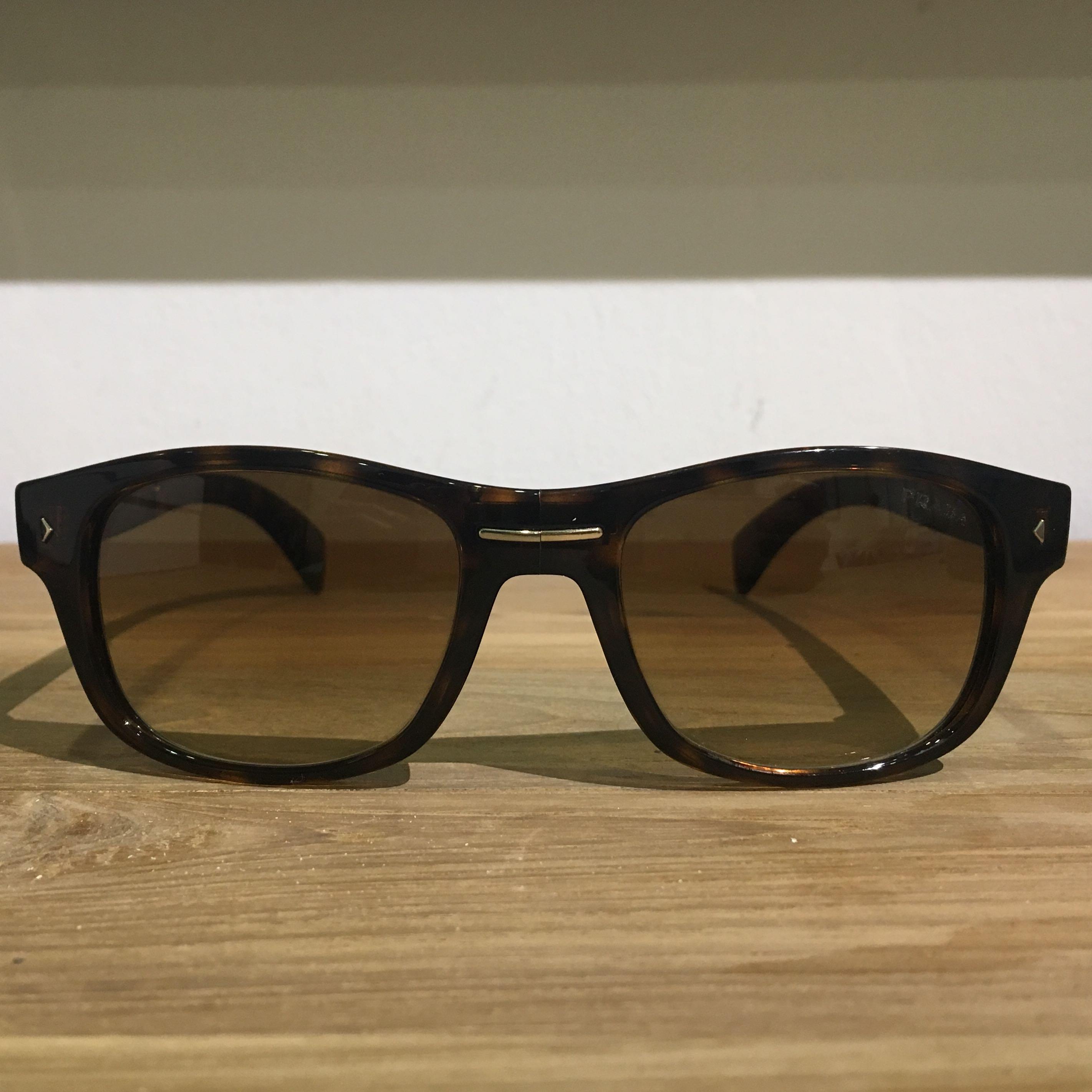 ae1338547c Prada Tortoiseshell Sunglasses SPR14O