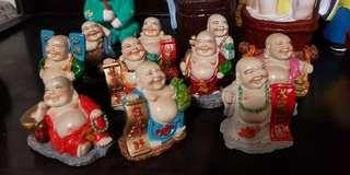 Small laughing monks figurines