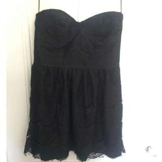 Strapless black mini dress with lace/overlay pattern
