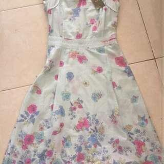 New cute Dress Light blue with flowers pattern
