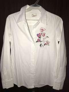 White, long-sleeved blouse
