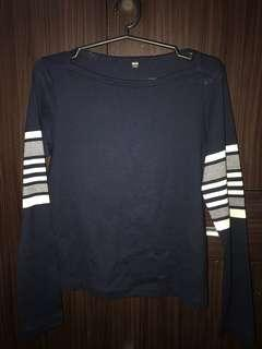 Dark blue, long-sleeved top with white stripes on sleeves