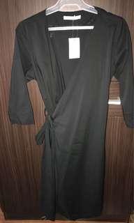 Black, below-the-knee, wrap-around dress