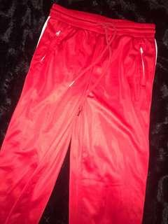 Fashion Nova Red Track Pants with White Side Stripe