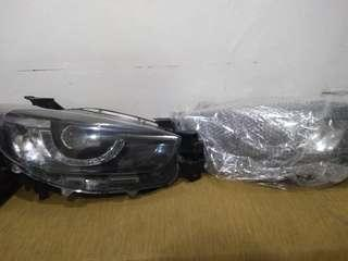 Headlamp proyektor Mazda CX-5 edisi ga jadi pake