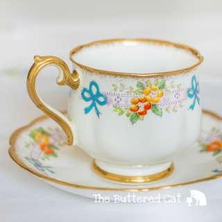 Antique 1930s Royal Albert cup and saucer, hand-decorated blue bows