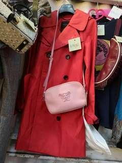 Coach trench coat & Versace bag
