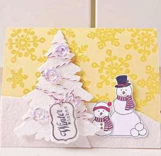 Happy winter Christmas handmade card Santa Claus and snow man