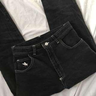 black mom jeans with contrast stitching