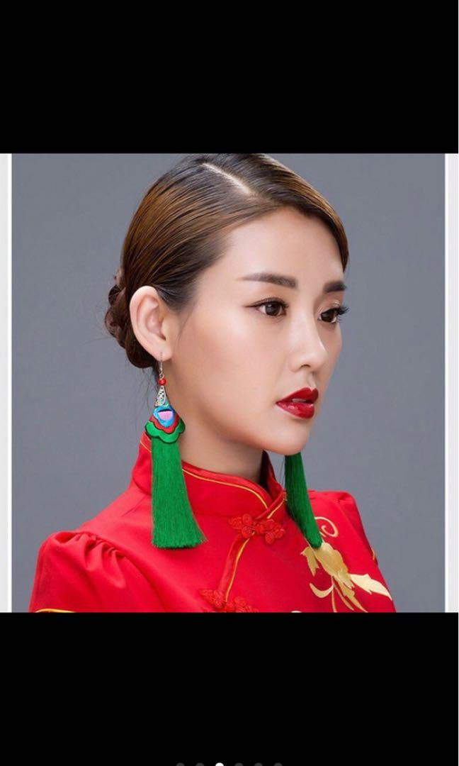Green tail earring
