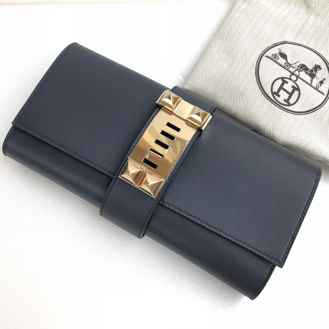 bc7492b29ff Hermes Blue Indigo Medor Clutch in Swift with Gold Permabrass ...