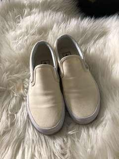 All white Vans size 7. It's still in excellent condition