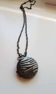new with box! zebra print metal magnetic locket