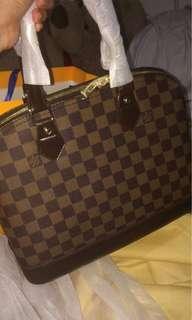 Lv alma hand/Sling bag