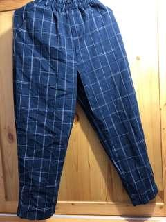 Navy trousers with white checked patterns