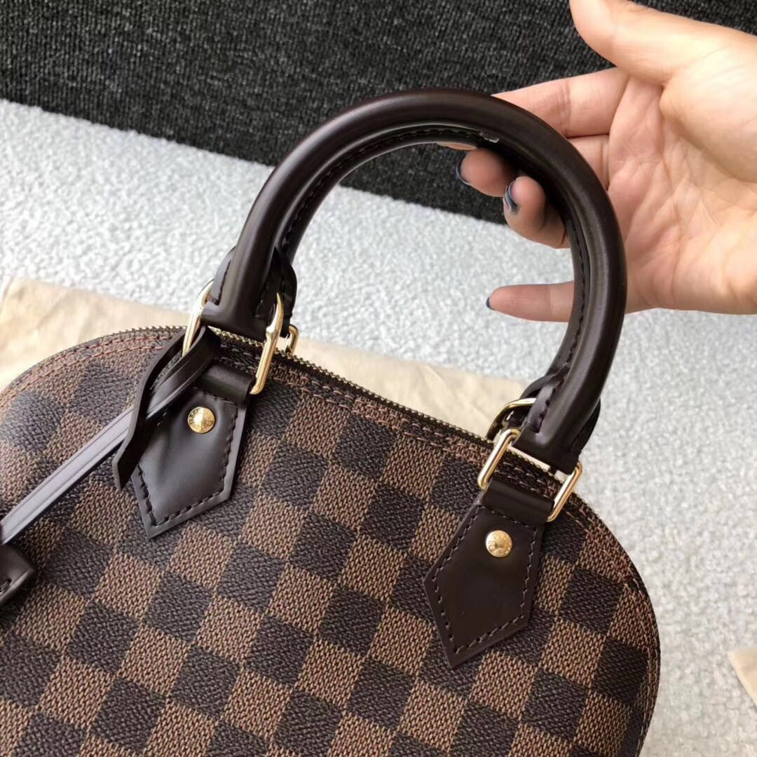 dbbf4d31e338 Pre-loved Authentic Louis Vuitton Alma BB Damier Ebene Canvas ...