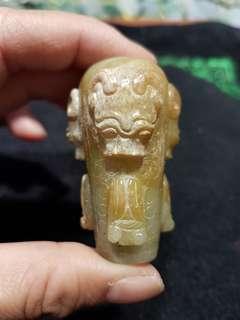 戰國黃玉浮雕工皮沙沁