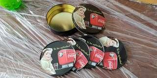 4 Vintage Coke coasters in a tin box