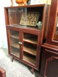 Pencil leg teak cabinet.