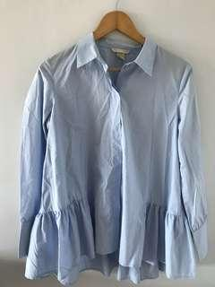 H&M blue long sleeves frill detail at the bottom