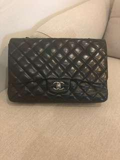 Authentic Chanel black lambskin quilted classic jumbo single flap bag