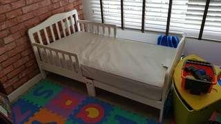 Toddler bed with Sealy waterproof mattress