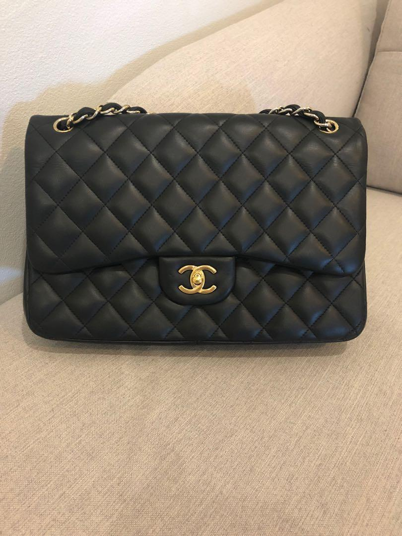 Authentic Chanel black lambskin quilted classic double flap bag GHW