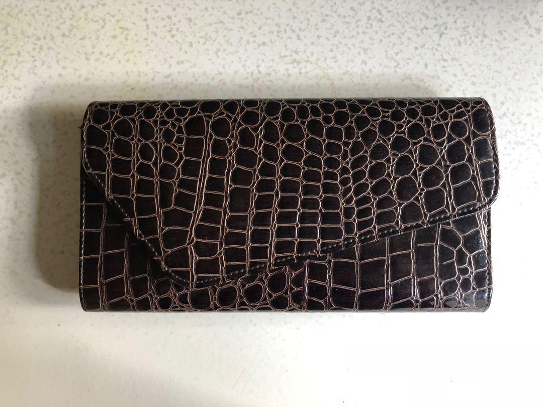 5339f42ae735 Burgundy Leather Clutch Bag