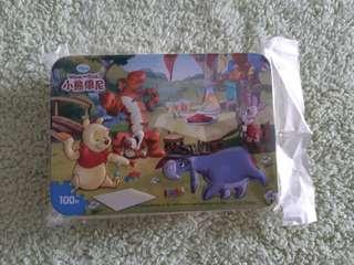 Paper puzzle in tin case
