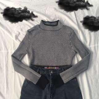 checkered mock neck sweater