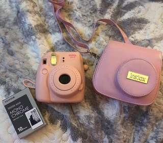 Pink Polaroid / Fujifilm Instant Mini with Polaroid Case, 10 Monochromatic photo film, and 5 photo films in the camera