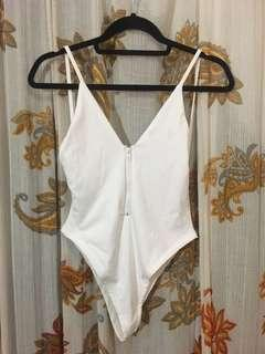 White one piece high wait bathing suit