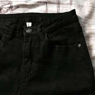 black jeans with knot ends