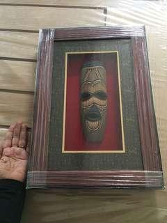 African Mask Sculpture in mounted frame