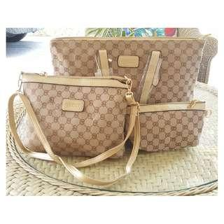 Gucci bundle bag with wrislet and shoulder bag