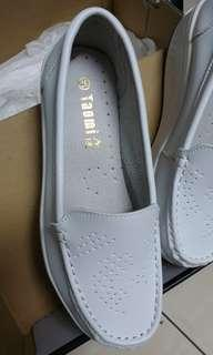 White casual wedge shoe