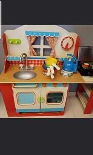 Solid wood kids kitchen with food and utensils