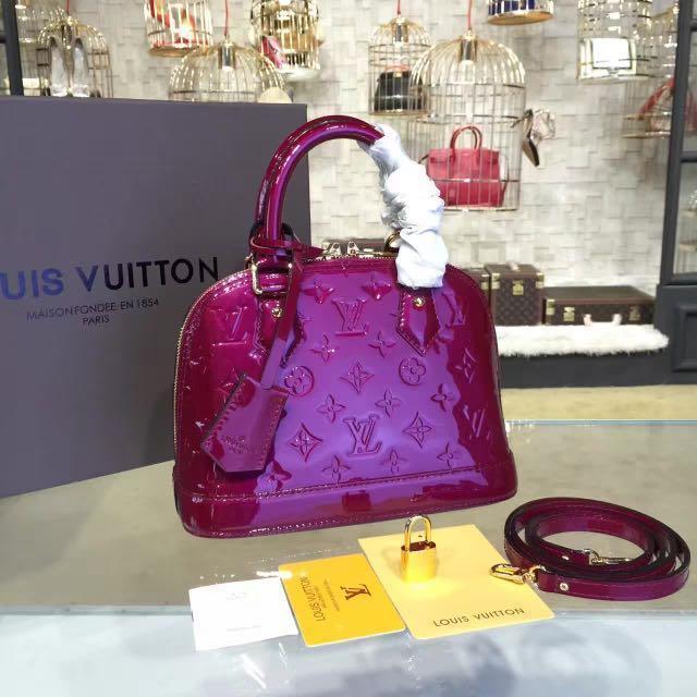 5c7bdbe4cbfd AUTHENTIC Louis Vuitton Alma BB in Magenta