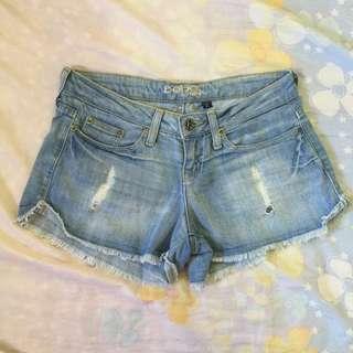 BEBE JEANS Raw Hem Denim Shorts
