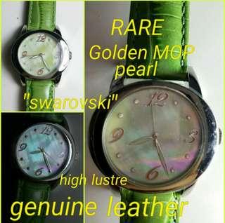 Golden mother of pearl green leather strap watch