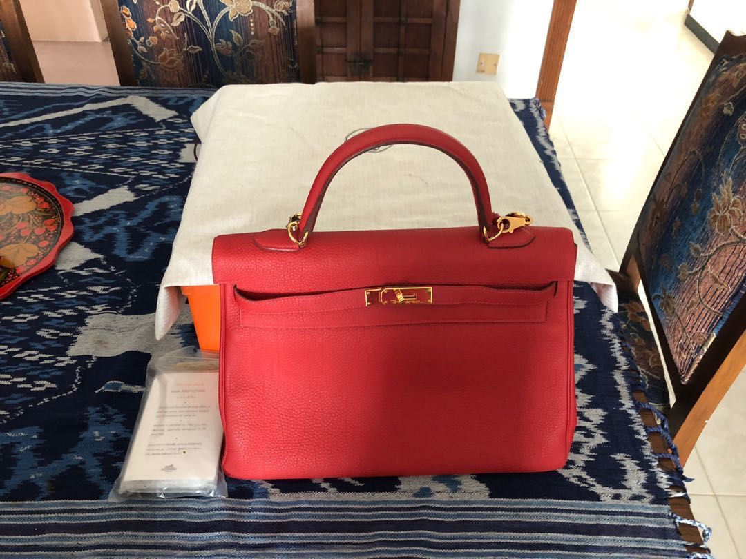 4576abfdea52 Hermès Kelly 35 Togo red vermillion stamp Q with gold hardware ...