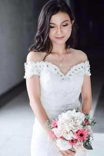 Off shoulder wedding gown for rent with trail
