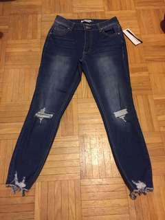 Brand new ripped jeans
